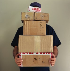Delivery Man Balancing Boxes
